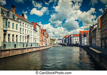 Vintage retro hipster style travel image of canal and old houses in Bruges (Brugge), Belgium