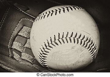 Vintage retro image of baseball and glove in old antique plate style of photograph