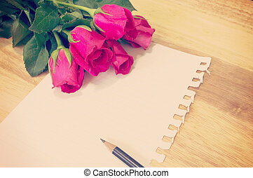 Vintage, retro of note book paper and pencil with rose