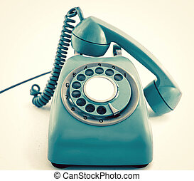 vintage retro phone in cyan blue close up
