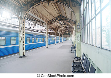 Vintage retro platform passenger railway station. Concept of meeting, waiting, seeing people on the road trip.