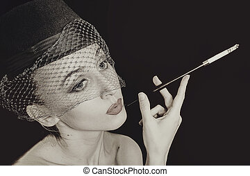 vintage Retro portrait of beautiful young caucasian woman in veil with cigarette