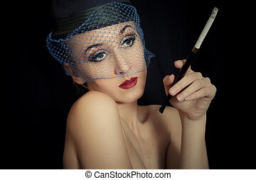vintage Retro portrait of beautiful young caucasian woman in veil with cigarette closeup