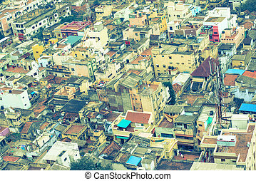 Vintage retro style  image of colorful homes in crowded Indian city Trichy,  India, Tamil Nadu