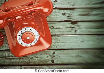 Vintage retro telephone on the wood background.