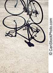Vintage road bicycle and its shadow