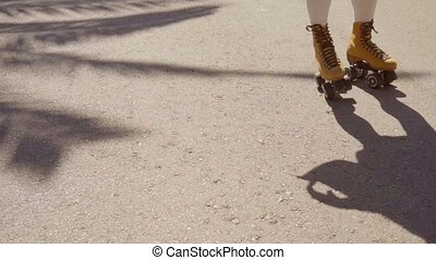 Vintage Roller Skater On The Street. - Close-up of female...