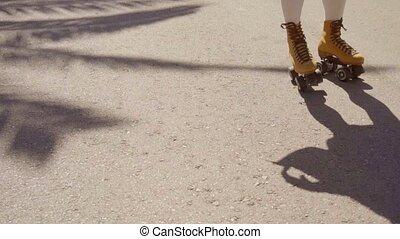Vintage Roller Skater On The Street. - Close-up of female...