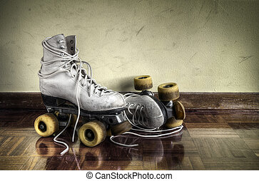 Vintage roller skates with big shoe-laces on a yellow wall...