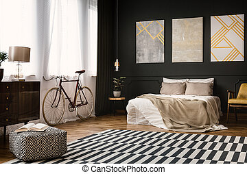 Vintage room with bed, bike, carpet on the floor and pouf