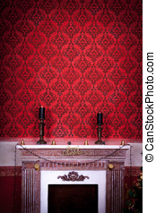 Vintage room with two candels on a fireplace on a red...