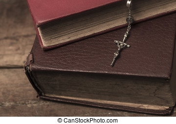 vintage rosary beads on old books