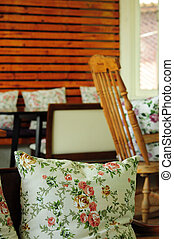 Vintage rose pillow and Rocking chair