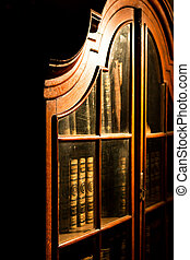 Vintage Russian wooden bookcase in the library. Collection of old books.