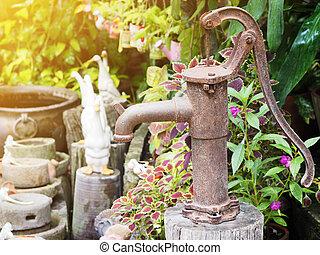 Vintage rusty hand water pump