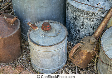 vintage rusty oil cans