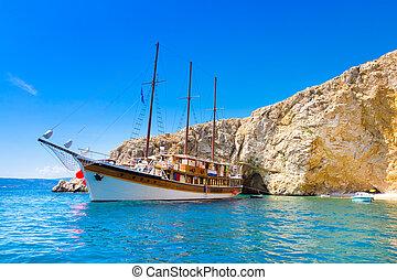 Vintage sailing boat in bay.