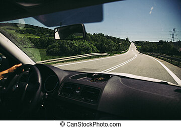 Vintage scene of driving car on road, vacations faded concept