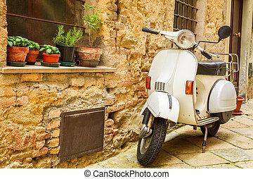 Vintage scene with Vespa on old street