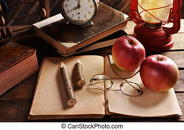 vintage school concept with old notebook, pencils, books and...