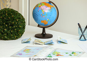 school globe and books on the table