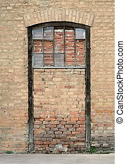 vintage sealed door with brick wall