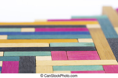 Vintage Set of Cuisenaire Rods laid out in a random order against a white background