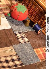 Vintage sewing basket and patchwork quilt