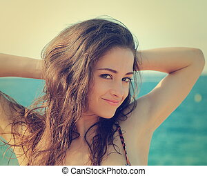 Vintage sexy woman portrait joy on sea background. Closeup