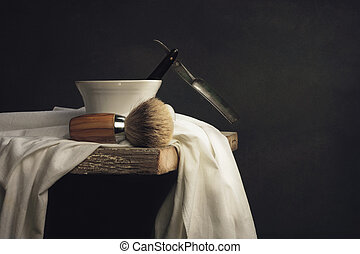 Shaving Tool on wooden Table and dark Background
