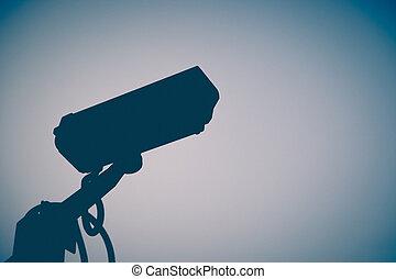 Vintage Siluate CCTV camera with bluesky background