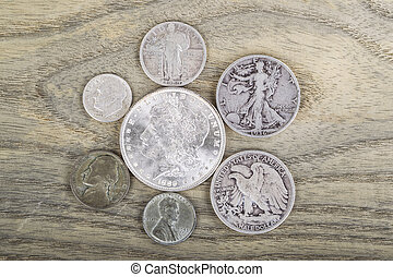 Vintage Silver Coins - Old Silver Coins on faded white ash...