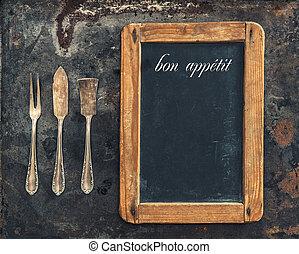 Vintage silver cutlery and blackboard. Retro style