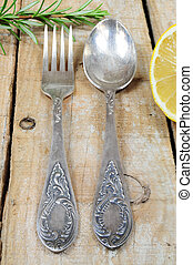 Vintage silver fork and spoon on wooden background