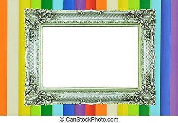 Vintage silver picture frame on rainbow colorful wall