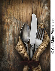 Vintage silverware on rustick wooden background