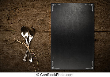 Vintage slate chalkboard template menu and spoon and fork on...