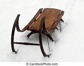 vintage sled in the snow