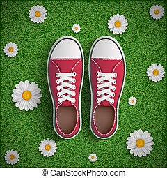 Vintage sneakers standing on green grass