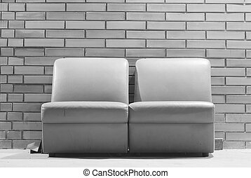 vintage sofa with brick wall background