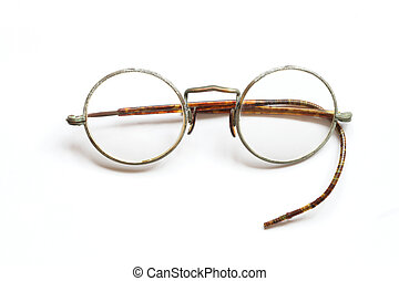 Vintage spectacles - Old spectacles without one side lying...
