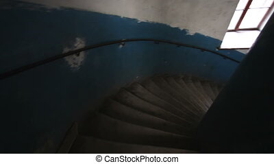 Vintage spiral stairs POV, slow motion