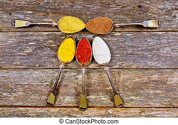 Vintage spoons with different spices on a white background. Pepper mix, paprika, dry ginger, cumin, thyme. Ingredients and seasoning.