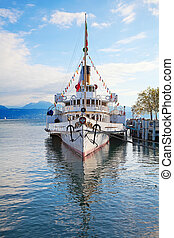 Vintage steam boat at the pier on lake Leman(Genaeva lake)