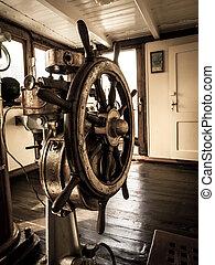 Vintage steering wheel - Steering wheel in the old war ship