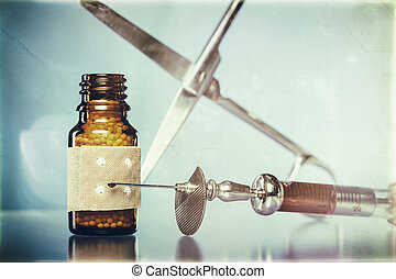 vintage still life with homeopathy globules. syringe with blood,