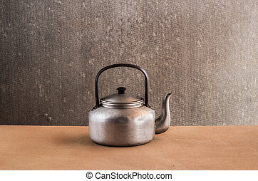 Vintage still life with Kettle on wooden
