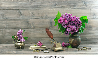 vintage still life with lilac flowers in vase