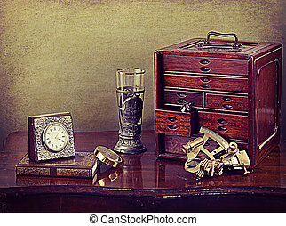 Vintage still life with old object and tools on a wooden table
