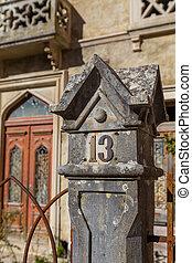 stone square decoration on pillar of fence